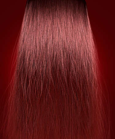 straggly: A perfect symmetrical view of a bunch of frizzy unkempt red hair on an isolated background