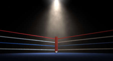 boxing match: A closeup of the red corner of a regular boxing ring surrounded by ropes spotlit by a spotlight on an isolated dark background