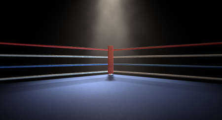 pelea: Un primer plano de la esquina roja de un ring de boxeo normal rodeado de cuerdas spotlit por un foco sobre un fondo oscuro aislado Foto de archivo