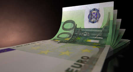greenbacks: A group of five euro banknotes fanned out and curved on an isolated white background