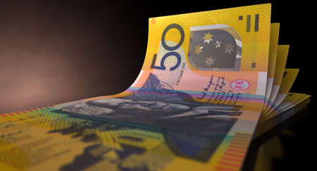 greenbacks: A group of five australian dollar banknotes fanned out and curved on an isolated white background