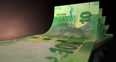 rand: A group of five rand banknotes fanned out and curved on an isolated white background