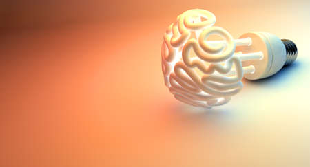 An illuminated fluorescent light bulb in the shape of a stylized brain on an isolated colorful studio background photo