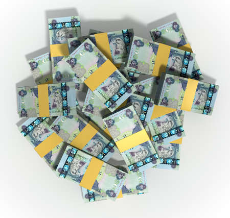 randomly: A pile of randomly scattered wads of dirham banknotes on an isolated background