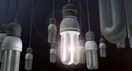 light fitting: A concept image showing unlit dangling flourescent light bulbs with one shining brighly showing leadership and innovation on an isolated dark background