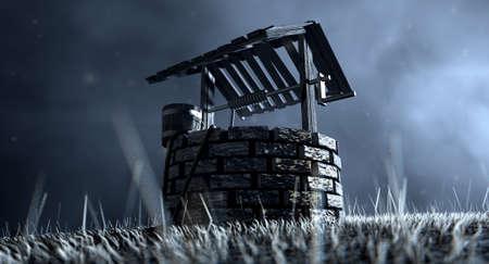 Une vue obsédante d'un puits d'eau en briques avec un toit et seau en bois attaché à une corde dans une prairie herbeuse éclairée par une lune en début de soirée sur un fond sombre Banque d'images