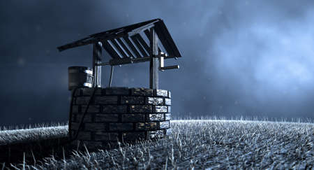 A haunting view of a brick water well with a wooden roof and bucket attached to a rope in a grassy meadow lit by an early evening moon on a dark background