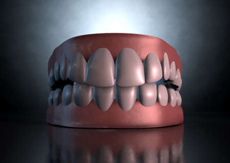 lower teeth: A sinister dramatic depiction of seperated upper and lower sets of human teeth set in gums on a dark eerie spotlit background