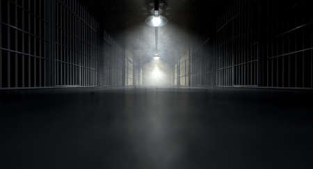 A concept image of an eerie corridor in a prison at night showing jail cells dimly illuminated by various ominous lights Stock Photo