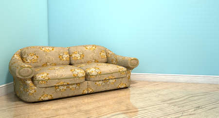 An old vintage sofa with a floral fabric in the corner of an empty room with light blue wall and a reflective wooden floor photo