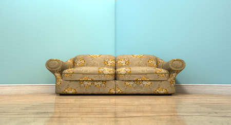 An old vintage sofa with a floral fabric in the corner of an empty room with light blue wall and a reflective wooden floor Stock Photo