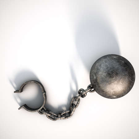 restraining device: A vintage ball and chain with an open shackle on an isolated white studio background Stock Photo