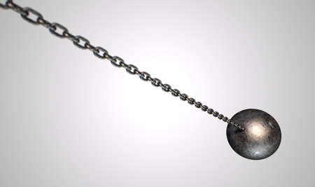 ball and chain: A regular metal wrecking ball attached to a chain on an isolated white background Stock Photo