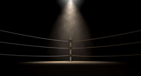 boxing match: A closeup of the corner of an old vintage boxing ring surrounded by ropes spotlit by a spotlight on an isolated dark background