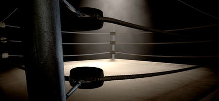 boxing sport: A closeup of the corner of an old vintage boxing ring surrounded by ropes spotlit by a spotlight on an isolated dark background
