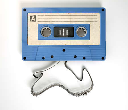 unwound: A concept view of a vintage audio cassette tape with a white label with an unravelled ribbon that splits into musical lines and notes on an isolated white background Stock Photo