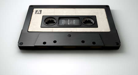 audio cassette: A close up view of a black vintage audio cassette tape with a white label on an isolated white background