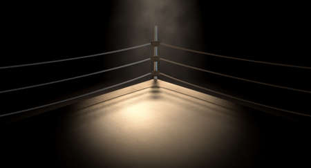 A closeup of the corner of an old vintage boxing ring surrounded by ropes spotlit by a spotlight on an isolated dark background