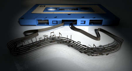 A concept view of a vintage audio cassette tape with a white label with an unravelled ribbon that splits into musical lines and notes on an isolated white background Stock Photo
