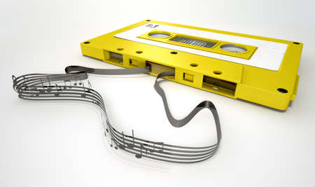 audio cassette: A concept view of a vintage audio cassette tape with a white label with an unravelled ribbon that splits into musical lines and notes on an isolated white background Stock Photo