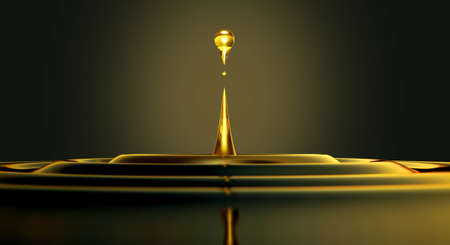 An extreme close up of a drop of oil creating ripples on an isolated black background Stock Photo