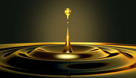 An extreme close up of a drop of oil creating ripples on an isolated black background