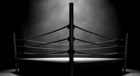 An old vintage boxing ring surrounded by ropes spotlit in the middle on an isolated dark background