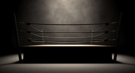 spotlit: An old vintage boxing ring surrounded by ropes spotlit in the middle on an isolated dark background