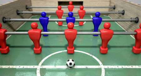 contestant: One half of a foosball table at ground level with a soccer ball in front of the red team ready to kick off a soccer match Stock Photo