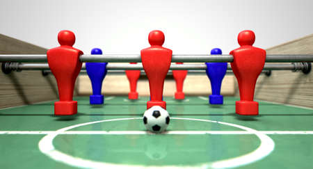 one level: One half of a foosball table at ground level with a soccer ball in front of the red team ready to kick off a soccer match Stock Photo