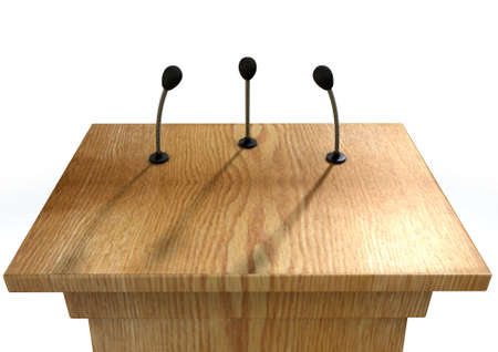podium: A wooden speech podium with three small microphones attached on an isolated white studio background