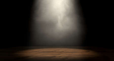 An stage lit by a single spotlight on a dark background