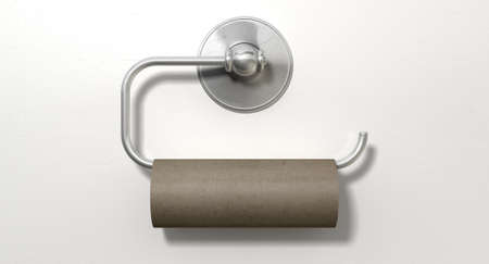An emptied roll of toilet paper hanging on a chrome toilet roll holder on an isolated white textured background Stock Photo