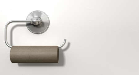An emptied roll of toilet paper hanging on a chrome toilet roll holder on an isolated white textured background Standard-Bild