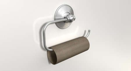 An emptied roll of toilet paper hanging on a chrome toilet roll holder on an isolated white textured background photo