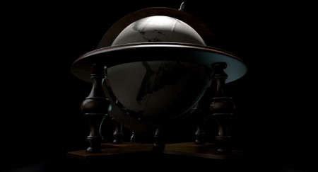 A vintage wooden world globe ornament backlit on an isolated black background photo