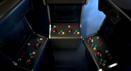 unbranded: A group of vintage unbranded arcade games with a joysticks and buttons and a blank screen huddled facing each other on a dark ominous background with copy space