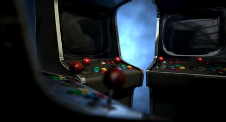 arcade games: A group of vintage unbranded arcade games with a joysticks and buttons and a blank screen huddled facing each other on a dark ominous background with copy space