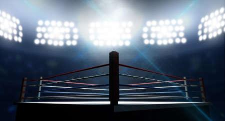 cerillas: Un ring de boxeo rodeado de cuerdas spotlit por focos en un escenario de ajuste en la noche