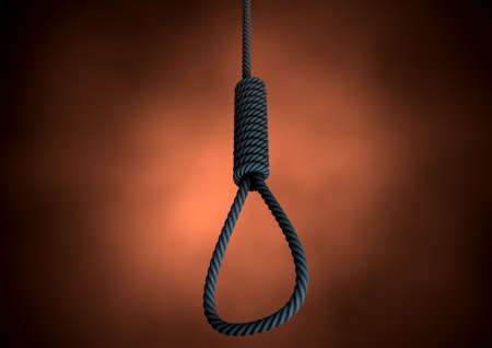 capital punishment: An eerie silhouetted view of a rope made into a hangmans noose on an orange backlit background Stock Photo