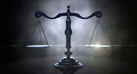 justice legal: An gold justice scale backlight an an eerie dark background Stock Photo