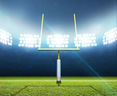 Een voetbalstadion met berichten op een duidelijke groene grasveld in de nacht verlicht door een reeks schijnwerpers
