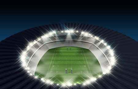 A rugby stadium with rugby posts on a marked green grass pitch in the night time illuminated by an array of spotlights photo