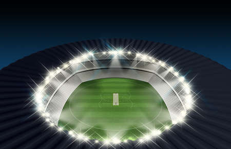 cricket game: A cricket stadium with a pitch on a marked green grass field in the night time illuminated by an array of spotlights