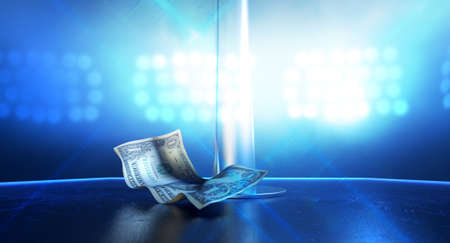 An isolated stripper pole on a stage lit by a single spotlight with only one crumpled up one dollar bill tip on a stripclub background photo