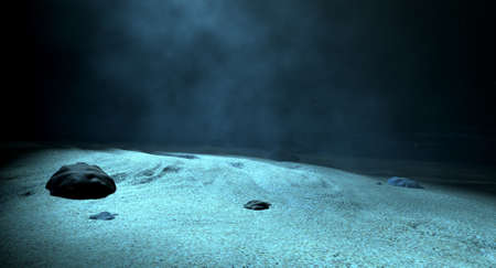 submerge: An underwater scene at the bottom of the ocean floor showing sand and emanating sunlight beaming through