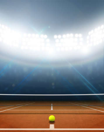 tennis stadium: A tennis court in an arena with a marked orange clay surface at night under illuminated floodlights