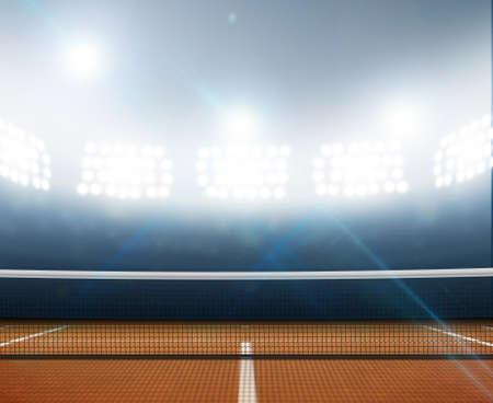 jugando tenis: Una pista de tenis en una arena con una superficie de arcilla naranja marcada por la noche con luz artificial iluminadas