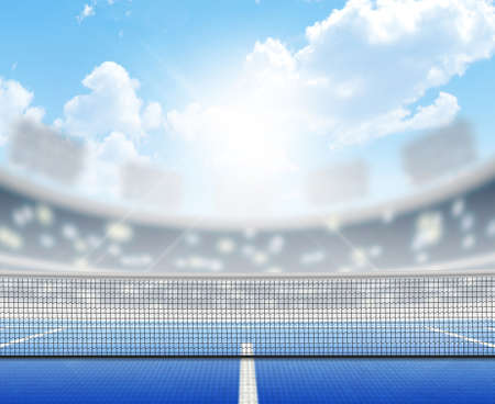 A tennis court in an arena with a marked hard blue surface in the daytime under a blue sky