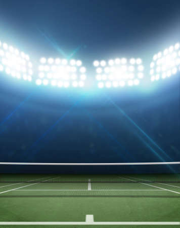 floodlit: A tennis court in an arena with a marked green hard surface at night under illuminated floodlights